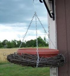 This is a cute way to make a bird bath or bird feeder using a grapevine wreath. Get a grapevine wreath and a shallow planter bottom that you put under the planter to hold water in.
