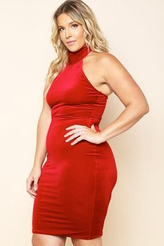 A plus size sleeveless bodycon dress with a high halter turtleneck and a bowed back. Velvet all over.