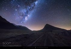 Parallels  The galactic center of our Milky Way rises above farmland on the…