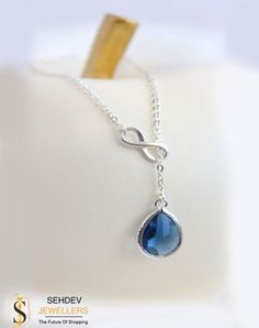 f6f9435c0d54a Sapphire Blue Teadrop and Silver Infinity Lariat Necklace.