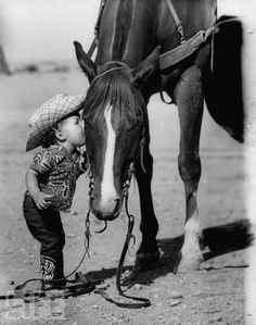 little cowboy, how cute. Look how the horse puts his head down for the little cowboy...