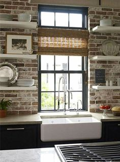 Love the floating shelves and farmhouse sink