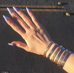 Closed tight: The gold bangles are sealed shut with a screwdriver and were modeled off chastity belts