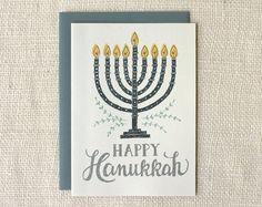 Happy Hanukkah Greeting Card - Blank inside - Size: x - Envelopes: steel blue - Paper: recycled, speckled cardstock - Packaging: cellophane sleeve - Printed in the USA Hanukkah Greeting, Hanukkah Cards, Hanukkah Decorations, Christmas Hanukkah, Holiday Greeting Cards, Christmas Cards, Blue Envelopes, Card Envelopes, Menorah