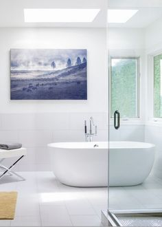 We love the white Boyce Acrylic Tub in this minimalist bathroom. Add a pop of color in an all-white bathroom to obtain this sophisticated and modern look.