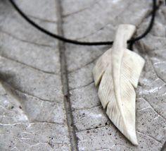 Carved elk antler feather pendant. $37.00, via Etsy.