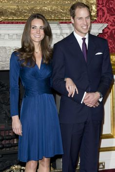 Oh my God I just LOVE that royal blue dress.[Kate Middleton & Prince William announcing their engagement]
