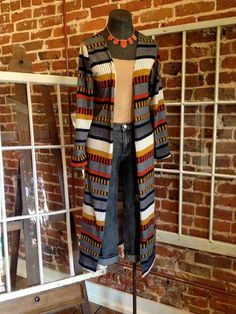 Loving this new cardigan! Longer length with an awesome print...so comfy! Come by and get yours or order online here: http://8thstreetboutique.com/collections/new-arrivals/products/multicolor-striped-maxi-cardigan
