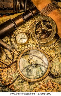 stock-photo-vintage-magnifying-glass-compass-telescope-and-a-pocket-watch-lying-on-an-old-map-132954599.jpg (300×470)