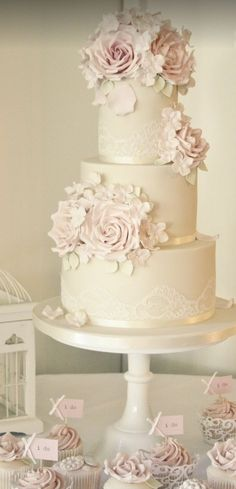 Featured Cake: Cotton & Crumbs; Romantic three tier blush pink flower detailed white wedding cake