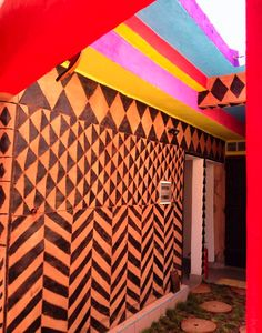 Maison d'Hotes Chez Giuliana in Ouagadougou, Burkina Faso. Where the rainbow meets African art. Stunning.