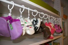 Use a tension rod and shower curtain clips to keep babies shoes organized! Such a good idea