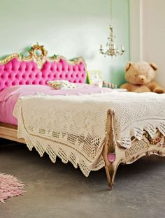 princess bed. with tufted pink headboard. lace. and a giant bear.