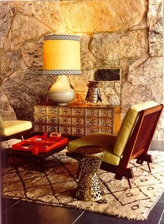 beni ourain carpet with mid century modern  furniture & a custom jonathan adler lamp  via elle deco
