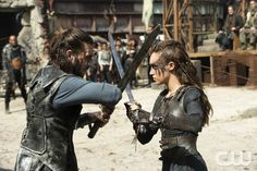 """The 100 -- """"Watch The Thrones"""" -- ImageHU304a_0123 -- Pictured (L-R): Zachary McGowan as Roan and Alycia Debnam-Carey as Lexa -- Credit: Cate Cameron/The CW -- © 2016 The CW Network, LLC. All Rights Reserved"""