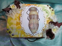 For this weeks challenge I have decorated another wooden box, I used my Bee digi from LEJ DesignsI have used the same technique as last time on the colouring, I coloured the image with Graph'it Markersand then used the blender pen to remove colour where the wings where then highlighted with a white gel pen, added clear glitter with a quickie glue pen and then added 3d glaze on top then layered it on to a Spellbinders die cut frame. the background on the box was made usingPanPastelsand… Blender Pen, White Gel Pen, Wooden Boxes, Altered Art, Colouring, Glaze, Markers, Bee, Wings