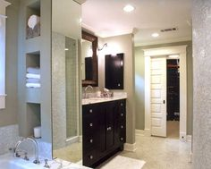 Lots of storage in this beautiful bathroom by Flatley Design