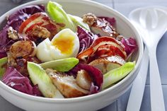 Serves 4PREP 25minsCOOK 1hr 1 lemon, quartered 2 thyme sprigs 1.2kg (size 12) chicken 1 1/2 tbsp olive oil 2 eschalots, peeled 2 garlic cloves, peeled 4 slices flat pancetta 2 tbsp raspberry or red wine vinegar 1 1/2 tbsp extra virgin olive oil 4 eggs, at room temperature 1 witlof 1 radicchio, torn 1/4 cup (30g) chopped toasted walnuts   1 Preheat oven to 200C or 180C fan. Place lemon quarters and thyme in cavity of chicken and tie legs with string. Season with salt. Heat olive oil in a…