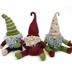 How cute are these hand-knit gnomes! They sit with open arms, a scraggly beard and adorably large hats that cover their whole face, except their nose that is! They're festive and jovial and full of li
