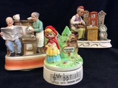 NICE LOT OF VINTAGE MUSIC BOXES AND ONE BISQUE FIGURINE OF A CLOCKMAKER, MADE IN JAPAN. THIS PIECE MEASURES 6 INCHES TALL. THE LITTLE RED RIDING HOOD MUSIC BOX IS MARKED PRICE IMPORTS JAPAN. LASTLY WE HAVE A 7 INCH SANKYO MUSIC BOX OF GRANDMA AND GRANDPA HAVING THEIR MORNING CUP OF COFFEE. BOTH MUSIC BOXES ROTATE ON THEIR BASES.