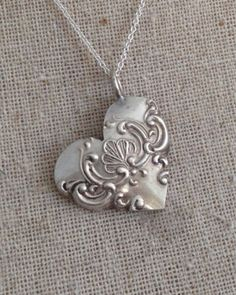 This necklace is made from a vintage silver fork which was cut down, filed into the shape of a heart and hung off a sterling silver chain.