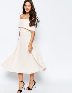 This nude off the shoulder dress is giving us all the glam vibes.
