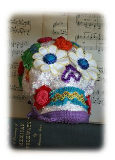 Make  your own Day of the Dead skull--gesso and glitter a plastic or paper mache skull, add vintage trims--I cut the decos off a thrift-store sweater.
