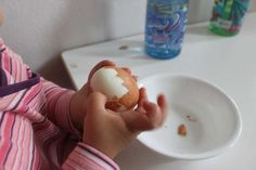 A 14 month old CAN peel an egg...give them a little instruction and the opportunity!