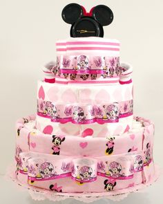 Minnie Mouse loves her bows! Perfect for a baby shower, this beautiful diaper cake is covered with cozy receiving blankets, booties, plush rattle, and more! Along with a generous supply of diapers, th