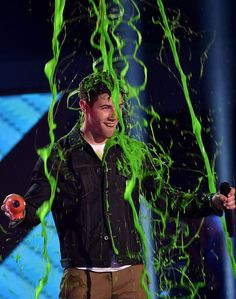 Nick Jonas got slimed at the Kids' Choice Awards! Find out who else got covered in green goo.