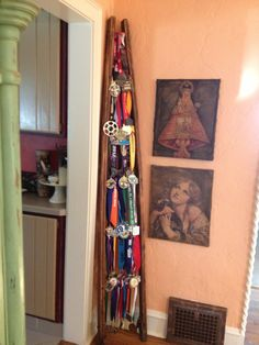 Race medal display idea using an old ladder