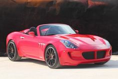 corvette engine + Pontiac Solstice  ... Tauro Sport Auto V8 Spider - red - front three-quarter view, top-down