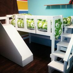 Loft bed with stairs and slide that my husband made for our son. Big boy bed.