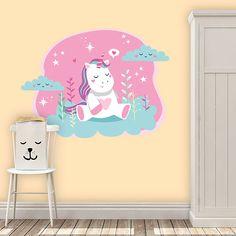 Illustración de un unicornio en un jardín con muchos colores. Utiliza este vinilo para decorar la habitación de los mas peques de la casa.