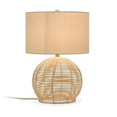 Hailey Home Bryn Rattan Rotary Socket Table Lamp with Fabric Shade at Lowe's. An intricate hand crafted natural rattan base is the main focal point of this ruggedly beautiful lamp. Beige Table Lamps, Rattan Lamp, Lamp Shade Store, Transitional Wall Sconces, Modern Coastal, Cool Floor Lamps, Lamp Sets, Fabric Shades, Drum Shade