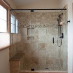 colorado springs bathroom remodel with travertine tile moen handheld shower bench and builtin shelf in colorado springs