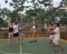 Playing some basketball with a few local kids.