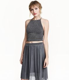Sleeveless cropped top in glittery jersey with narrow shoulder straps, racer back, and visible metal zip at back. Jersey lining.
