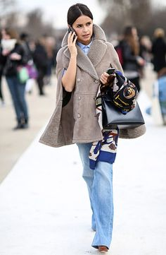 Miroslava Duma in taupe fur cape coat + blue shirt + wide denim pants + Hermes handbag + printed scarf street style during Fall Winter 2014 #PFW
