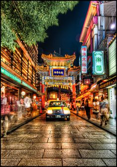Chinatown in Yokohama, Japan. There's a bustling chinatown in the city of Yokohama that sent my family into a tizzy, with vendors hawking their warm chestnuts and taxis lining the streets patiently for their fares.    7-exposure HDR joined in Photomati Do you love to Travel? Learn how to earn money doing what you love http://empowernetwork.com/brycewoodard