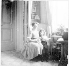 Olga Nikolaevna crocheting with her brother Alexei in the mauve room.