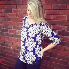 We cannot get enough of this classy print & super flattering fit!! This silky, flowy top is sure to please!  http://www.brandisboutiqueshop.co/item_2005/Navy-White-Swirl-Design-Top.htm.