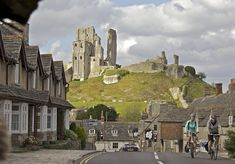 Corfe Castle: Does it get any more romantic than cycling through an English coastal town with a castle in the background? Image courtesy of VisitEngland/Weymouth and Portland Borough Council/Cycle West- Tim Pestridge.  Read more: http://www.lonelyplanet.com/travel-blog/tip-article/?p=71186#ixzz34uARokeG