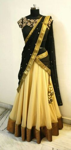 Cream lehanga, black dupatta or oni with polka dots and gold border, black blouse with floral work. Langa oni or half saree or ghagra. Mrunalini Rao.