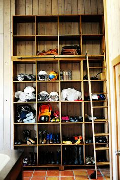 PW's mudroom.  So practical and cool-looking.   Wish I'd had this when I had kids playing football and soccer and snowboarding, etc.!