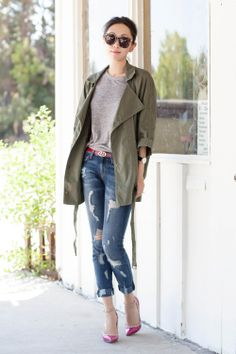 Top off ripped jeans with an army green parka