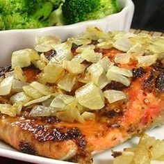 Spicy Salmon with Caramelized Onions | Salmon fillets are marinated with a spice paste and finished with caramelized onions in this quick and easy dish.