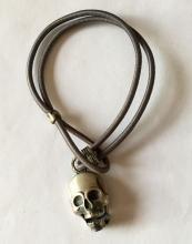 Gin metal color satin finish SCULL shape charm on rubber bracelet. Length 7