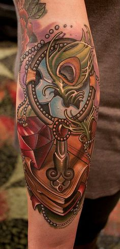 tattoo with ornate mirror, book, pearls, gem, peacock feather...by Timmy B -by Black 13 Tattoo