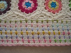 http://www.ravelry.com/projects/Tinaspice/crochet-hexagon-blanket